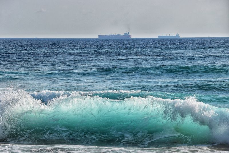 Shipping and waves Water Sea Sky Beauty In Nature Scenics - Nature Nature Horizon No People Breaking