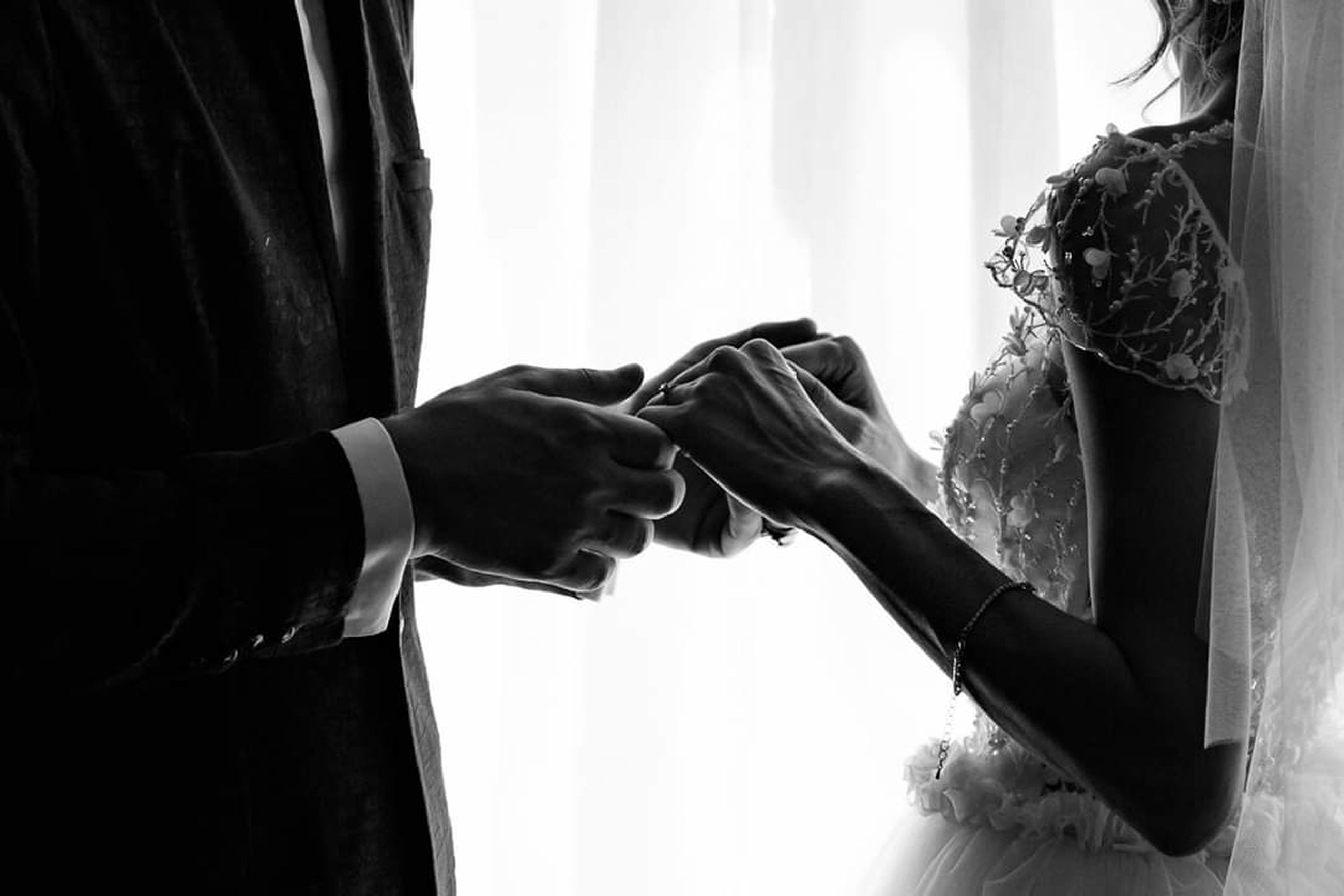 human hand, real people, midsection, indoors, hand, adult, men, wedding, women, holding, bride, newlywed, people, life events, human body part, two people, celebration, wedding dress, event, wedding ceremony, couple - relationship, getting dressed