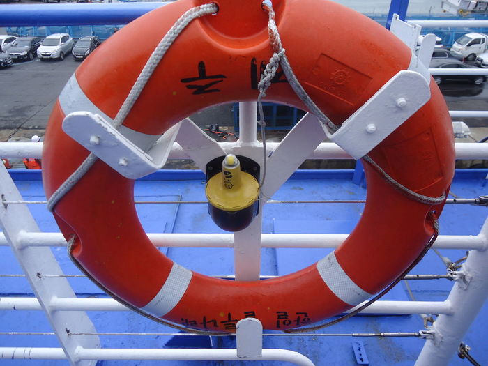 Safety First! Close-up Day Harbor No People Outdoors Protection Red Safety Safety Equipment Safety Ring Transportation Water