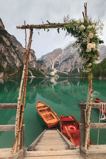 Flowers and wedding decoration at Lake Braies boathouse Romantic Trentino Alto Adige Wedding Beauty In Nature Boathouse Decoration Lago Di Braies Mode Of Transportation Mountain Mountain Range Nature Nautical Vessel No People Non-urban Scene Outdoors Pragser Wildsee Rowboat Scenics - Nature Sky Tranquil Scene Tranquility Transportation Tree Water Wood - Material