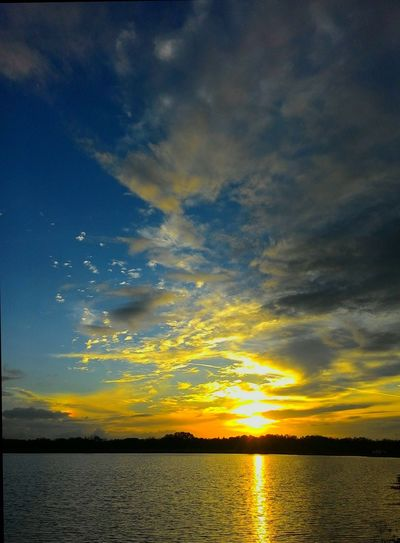 Sunset Nature Scenics Cloud - Sky Sky Water Dramatic Sky Reflection Tranquility Beauty In Nature Silhouette Outdoors Tranquil Scene No People Sea Travel Destinations Horizon Over Water Yellow Blue Landscape
