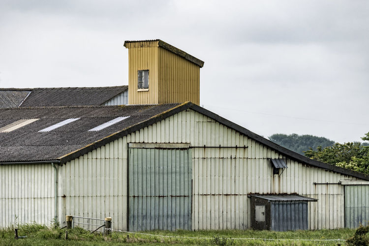 corrugated iron Architecture Building Exterior Built Structure Corrugated Iron Corrugated Iron House Day Grass No People North Germany Outdoors Schleswig-Holstein Sky