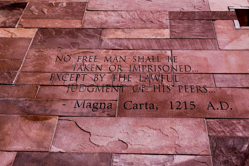 Article of Magna Carta text on of the old brick wall 43 Golden Moments Brick Wall Common Objects EyeEm EyeEm Gallery Getty Getty Images Historical Building Textured  Wall Article Background Background Texture Backgrounds History Law Magna Carta Stockphoto Stockphotography