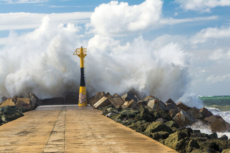 Pounding waves on a sunny day Anglet France Beauty In Nature Built Structure Capital Cities  Cloud Cloud - Sky Cloudy Day Nature No People Ocean Outdoors People Of The Oceans Scenics Sky Sunny Tourism Tranquility Travel Destinations Waves Crashing Weather Resist Premium Collection