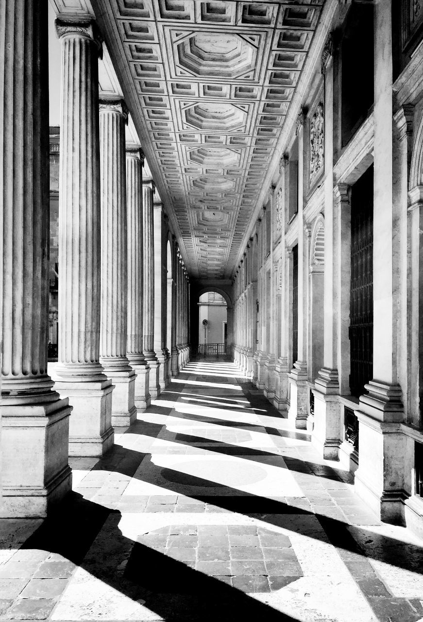 architecture, built structure, architectural column, building, arcade, history, the past, direction, corridor, no people, sunlight, the way forward, diminishing perspective, in a row, day, indoors, arch, shadow, colonnade, flooring, tiled floor, ceiling