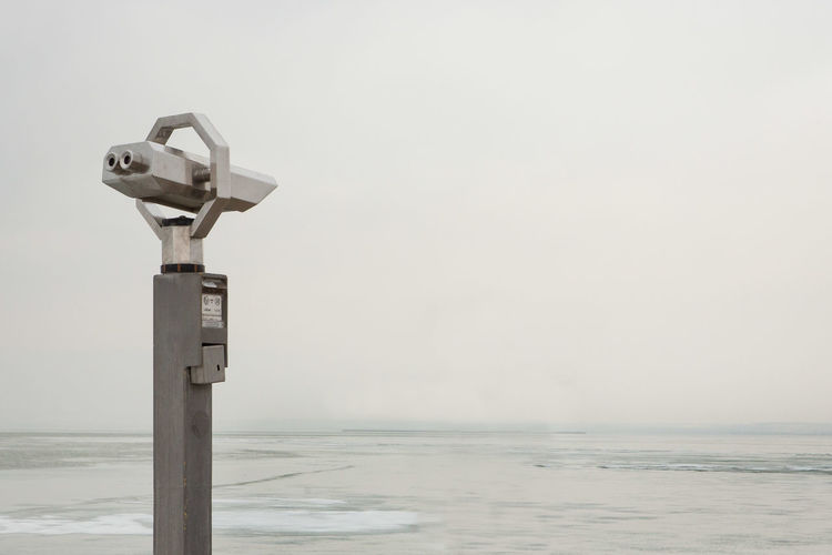 The Lookout Waiting Loneliness Empty Ice Floe Ice Overcast Cloudy Lookout Lake View Hand-held Telescope Security Coin Operated Binoculars Scenics - Nature Horizon Horizon Over Water Copy Space Day Surveillance Nature No People Sky Water Minimalism Minimalist