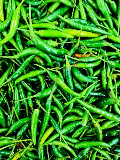 Full frame shot of green chili peppers