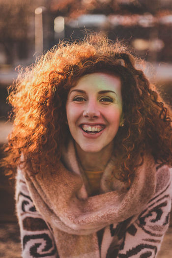 Close-Up Portrait Of Smiling Woman In Warm Clothing