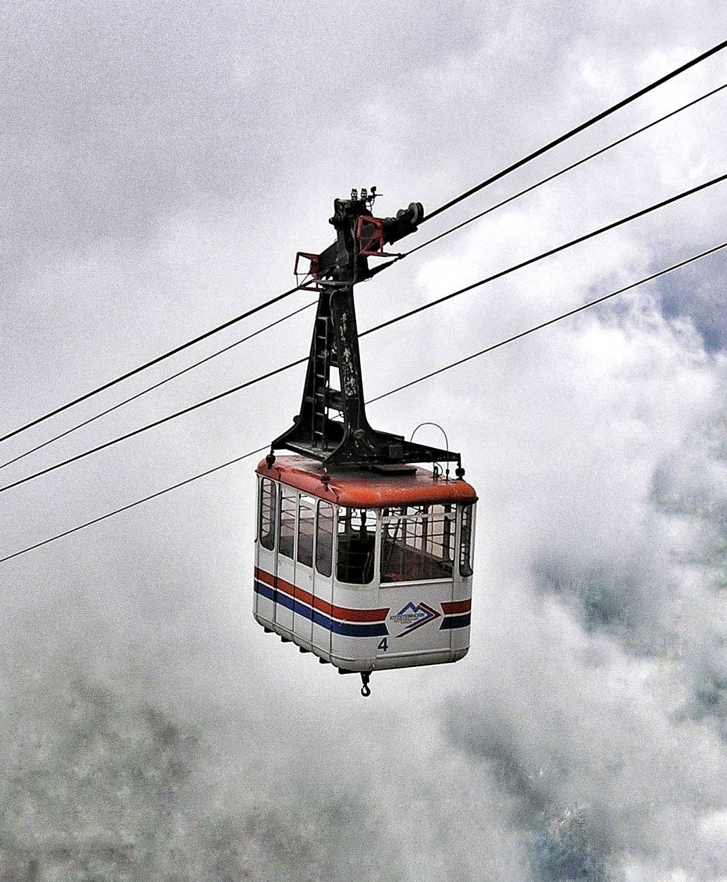 cloud - sky, sky, transportation, cable, day, low angle view, overhead cable car, outdoors, hanging, real people, nature, ski lift