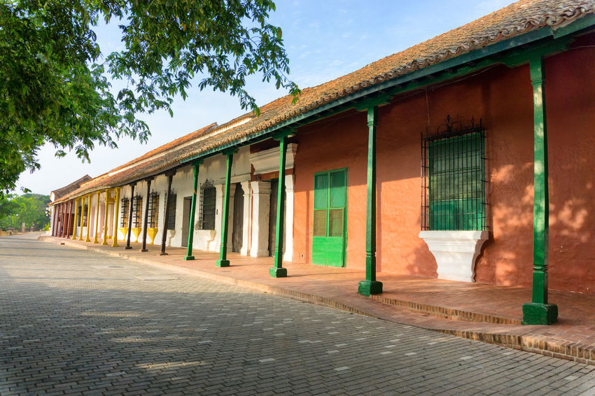 Beautiful colorful colonial architecture in the UNESCO World Heritage town of Mompox, Colombia America Arches Architecture Beautiful Bolivar Building Building Exterior Built Structure Colombia Colonial Colonial Architecture Downtown Façade Houses Mompos Mompox  Outdoors River Riverfront South Street Town Tree Unesco Waterfront