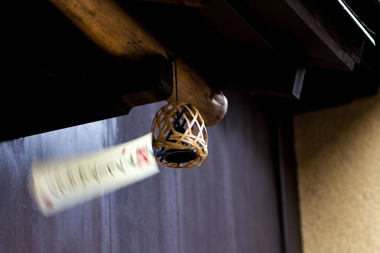 Low Angle View Of Lighting Decoration Hanging On Roof