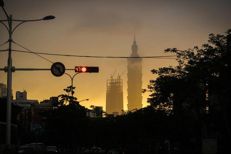 Silhouette of street lights at dusk