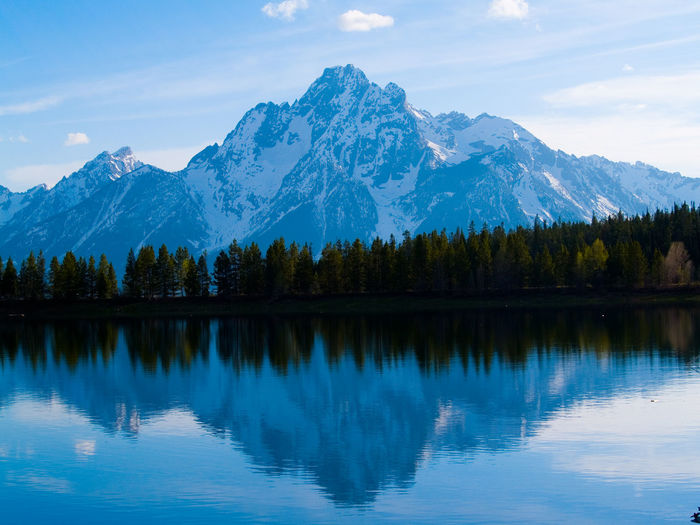 Grand Tetons National Park Reflections In The Water Reflections Mountain Range Blue Sky Still Water
