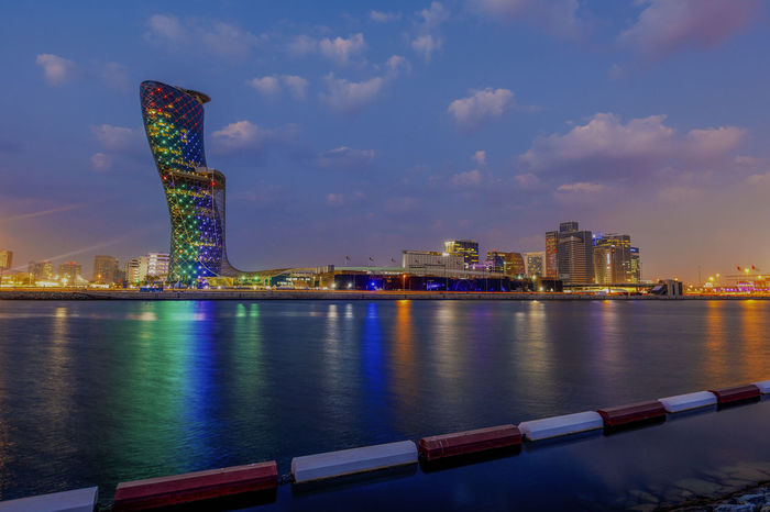 Twilight over the city, Abu Dhabi, UAE Abu Dhabi City Nightphotography Panorama Reflection Skyscrapers Twilight UAE Abudhabi Architecture Building Exterior Built Structure City Cityscape Cloud - Sky Illuminated Leaning Tower Modern Night No People Outdoors Sky Skyscraper Sunset Travel Destinations