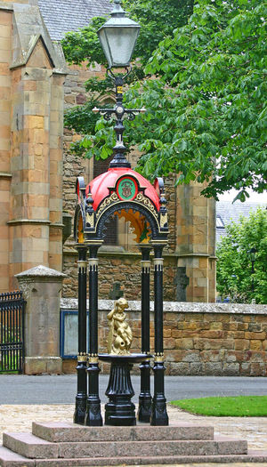 Unusual Street Lamp Architectural Column Architecture Building Exterior Built Structure Cast Iron Structure Day Drinkingwater Fountain No People Outdoors Scottish Highlands Statue Tree Victoriana Royal Durnark