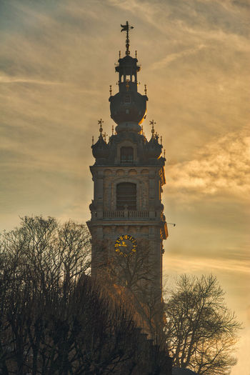 Architecture Bare Tree Bell Tower Building Exterior Built Structure Cloud - Sky Cross Day Low Angle View Nature No People Outdoors Place Of Worship Religion Sky Spirituality Sunset Travel Destinations Tree