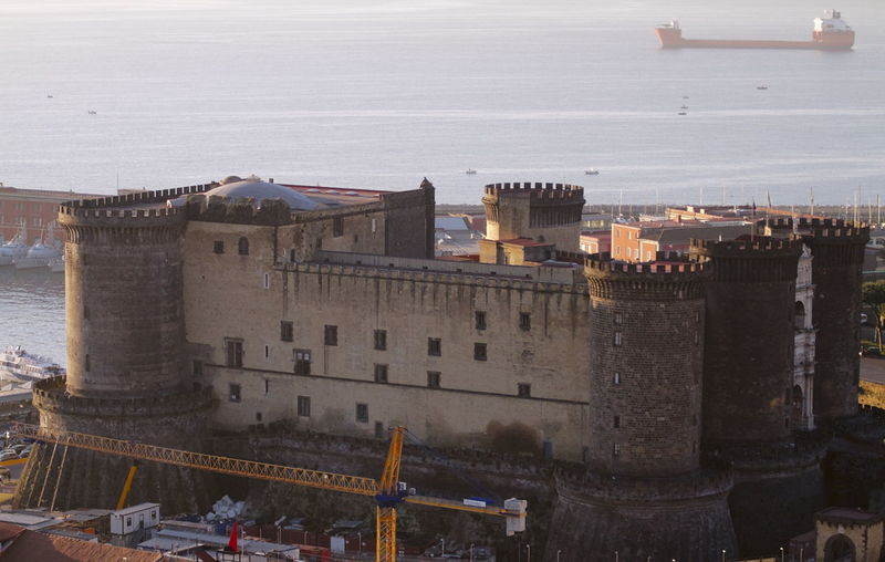 High angle view of castle by sea against sky