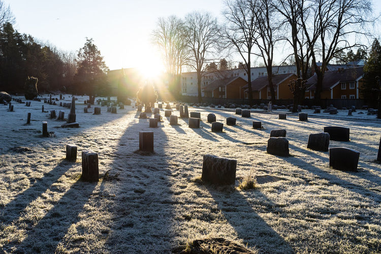 View of cemetery against sky during winter