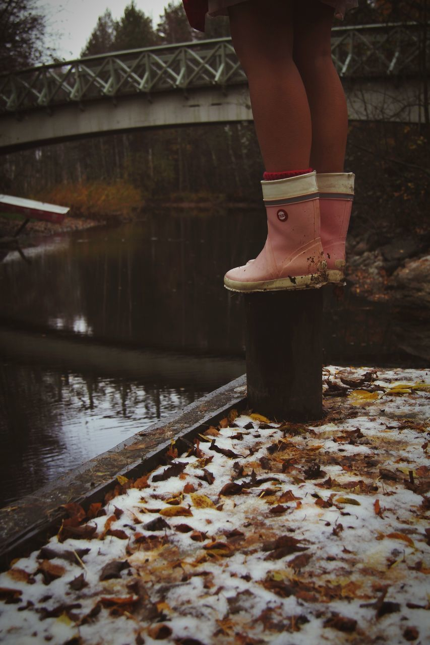 one person, real people, water, lifestyles, human body part, low section, body part, women, human leg, standing, nature, day, leisure activity, lake, architecture, outdoors, adult, shoe, human foot, human limb