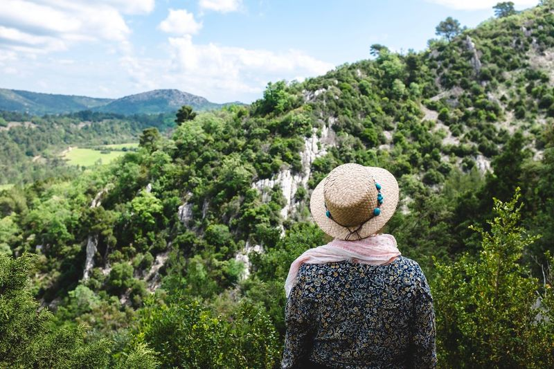 Rear view of woman looking at trees against sky in vauvenargues aix en provence