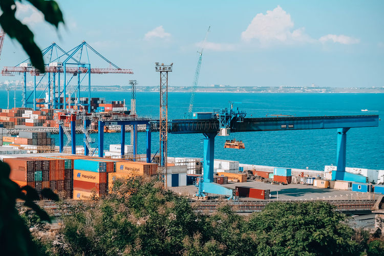 Commercial dock by sea against sky
