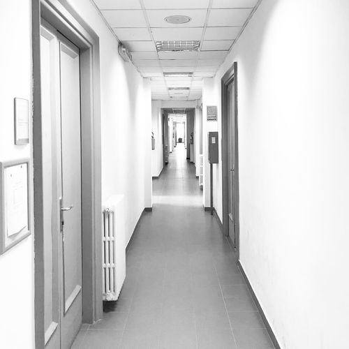University EyeEm Selects Corridor Architecture Arcade Building Indoors  Built Structure The Way Forward Flooring Healthcare And Medicine Direction Entrance Door Incidental People Lighting Equipment Ceiling Wall - Building Feature Diminishing Perspective Hospital Day