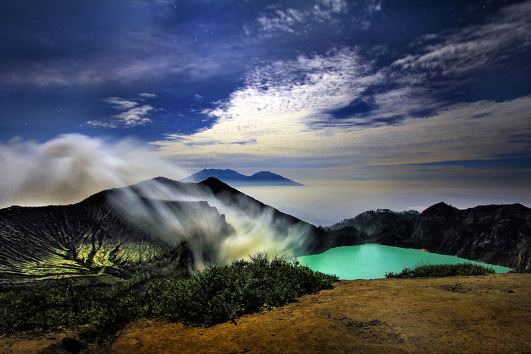 Ijen Crater Lake and Blue Flame, Bondowoso, East Java - Indonesia, The lake is recognised as the largest highly acidic crater lake in the world. Tourism Destination Tourism Holiday Tourist Destination Tourist Attraction  Tourist INDONESIA Bondowoso Night Lights Landscape_photography LargestintheWorld Largest Acidic Clouds And Sky Cloud Skyporn Sky And Clouds Mountain View Lake Lake View Crater Lake Crater Volcanic Crater Ijentravel Ijen Ijen Crater Idyllic Outdoors Tree Land Water Landscape Environment Nature Plant Mountain Tranquility Tranquil Scene Sky Scenics - Nature Cloud - Sky Beauty In Nature Day Wonderful View Wonderful Place Wonderful Indonesia