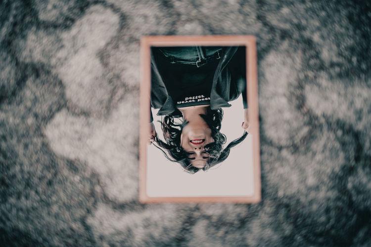 Portrait of woman in mirror