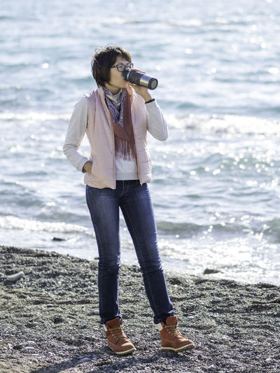 Full length of man photographing sea