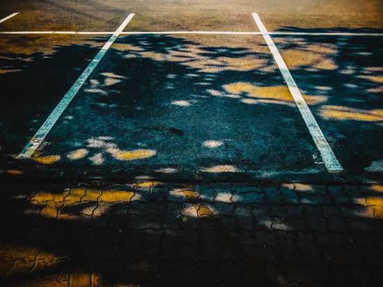 Outdoors Water Transportation Shadow Footpath Road High Angle View Reflection Nature Symbol Road Marking No People Sign Street Day Marking City Yellow Focus On Shadow Plant Part Dividing Line