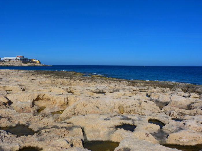 Malta Paceville Rock Coast Coast Beach Rock Beach Mediterranean  Mediterranean Sea Sea Water Horizon Rock Sky Horizon Over Water Solid Land Scenics - Nature Nature No People Clear Sky Blue Beauty In Nature