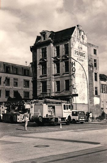 Old hotel at Hamburg Fischmarkt 1995 Building Exterior Architecture Built Structure Street City Outdoors Sky Day Hotel Old Broken Sign Firetruck Black And White Analogue Photography Old Police Car Street Photography The Street Photographer - 2017 EyeEm Awards Stories From The City
