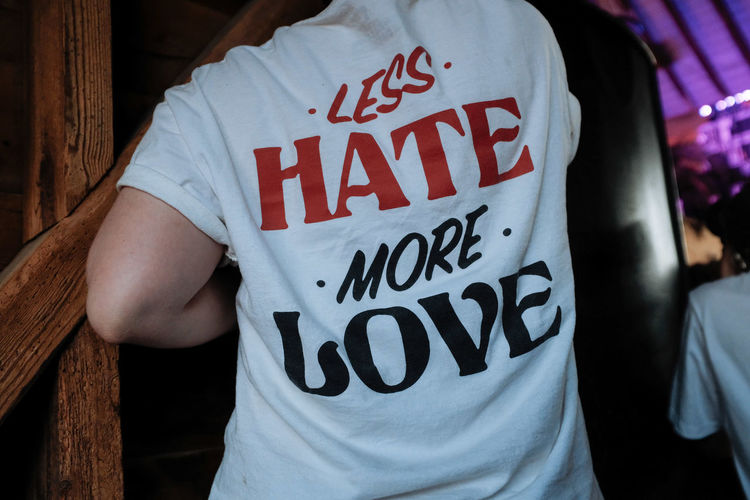 Midsection of person wearing t-shirt with text