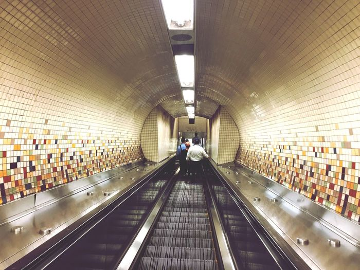 EyeEm Selects Indoors  Real People Illuminated Transportation Technology Large Group Of People Modern New York City Passenger Subway Station Commuter Men Travel Walking Built Structure Lifestyles Convenience The Way Forward Women Futuristic