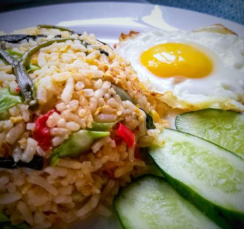 Egg Fried Egg Breakfast Food And Drink Food Healthy Eating Egg Yolk Indoors  No People Fried Ready-to-eat Fried Rice Freshness Close-up Plate Omelet Sunny Side Up Day Asianfood Asianbreakfast NasiGorengKampung Nasigoreng Whiteplate EyeEmNewHere