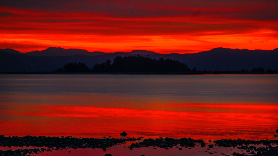 Beauty In Nature Day Dramatic Sky Growth Lake Landscape Mountain Mountain Range Nature No People Orange Color Outdoors Scenics Silhouette Sky Sunset Tranquil Scene Tranquility Tree Water