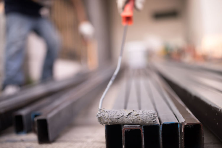 Close-up of railroad station platform