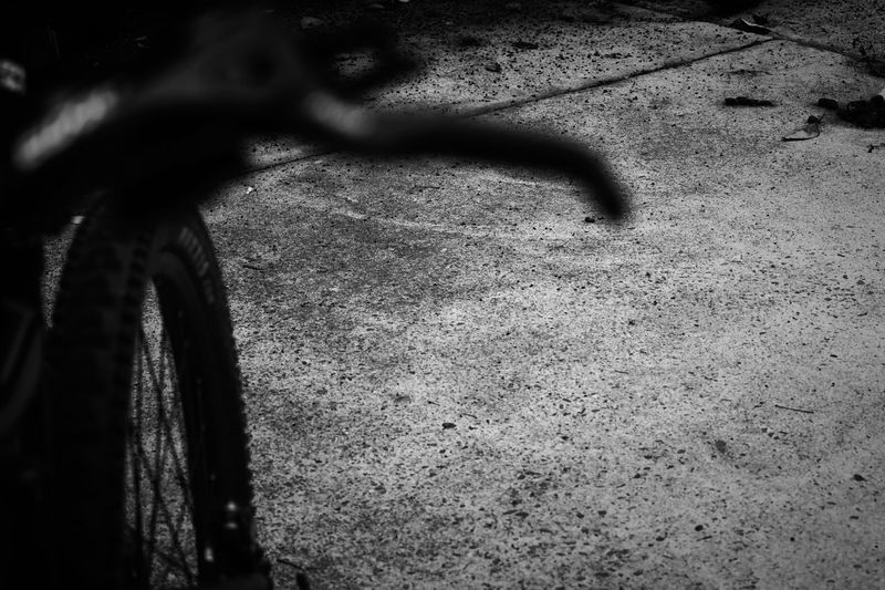 invisible No Budget Photography Whatever Perspective Black & White Black And White Blackandwhite Blackandwhite Dark Textured  Concrete Mountainbike MTB Bicycle Bike Lever Brake Lever Day High Angle View Shadow No People Outdoors Bicycle Transportation
