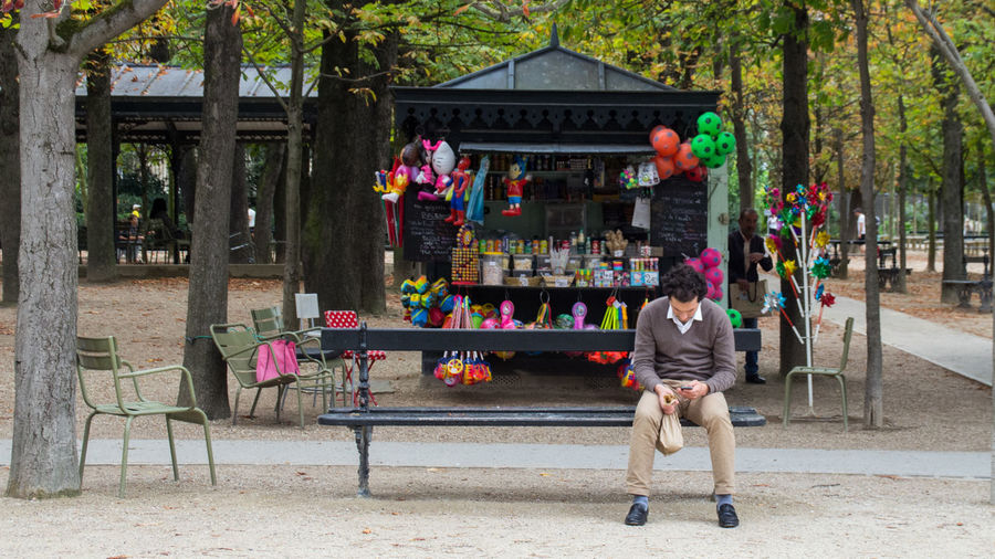 Architecture Built Structure Childhood Day France Gardens Jardin Du Luxembourg Lifestyles Men Outdoors Paris Park Park Bench Person Phone Toys Tree