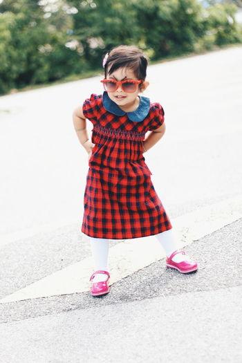 Full length of girl wearing sunglasses while standing on street
