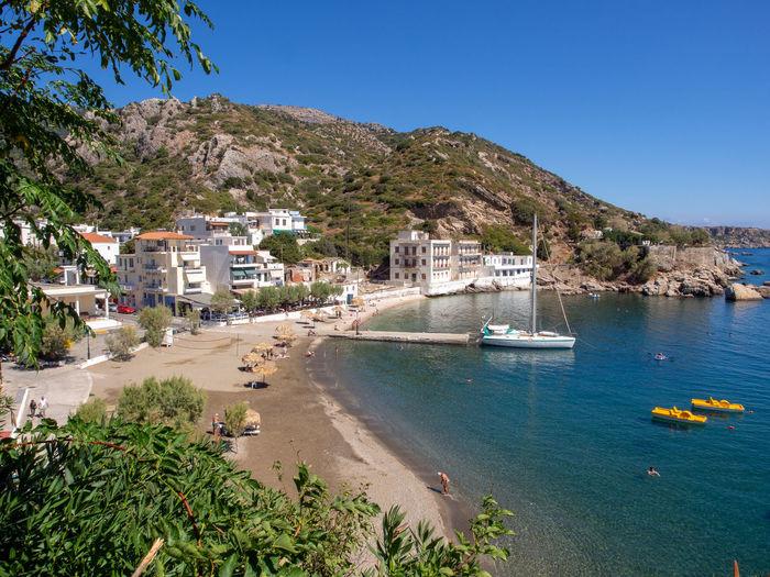 Therma village Ikaria Greece Greek Islands Island Architecture Water Outdoors Sea Sailboat Beach Bay Vacations Holiday Spa Village Longevity Greek