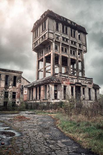 Abandoned old mine tower Construction High Industrial Sunlight Abandoned Aged Architecture Building Exterior Built Structure Cloud - Sky Damaged Day Dramatic Flare Mine Buildings No People Old Ruin Outdoors Scene Sky Storm Cloud Tower Vertical Windows The Week On EyeEm