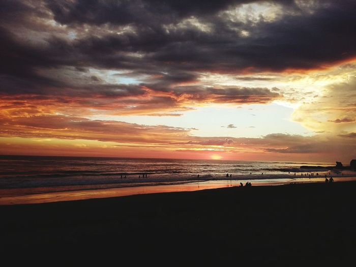 🏄 Beach Dramatic Sky Sunset Beauty In Nature Cloud - Sky Vacations Outdoors Sea No People Sand Horizon Over Water Nature Sky Wave Scenics