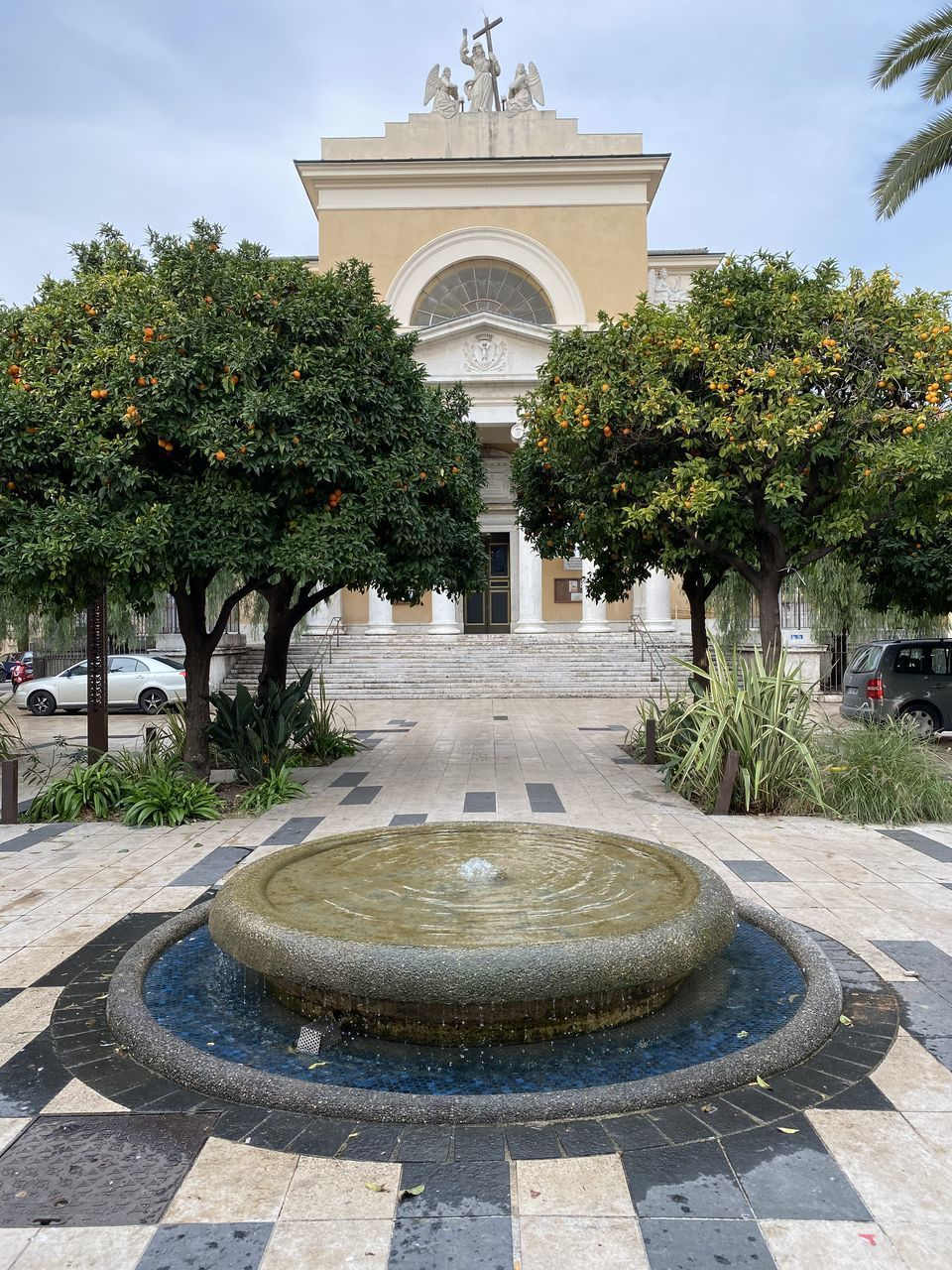 architecture, tree, plant, built structure, nature, building exterior, arch, fountain, water, outdoors, day, no people, garden, history, front or back yard, the past, sky, city, growth, architectural column, courtyard