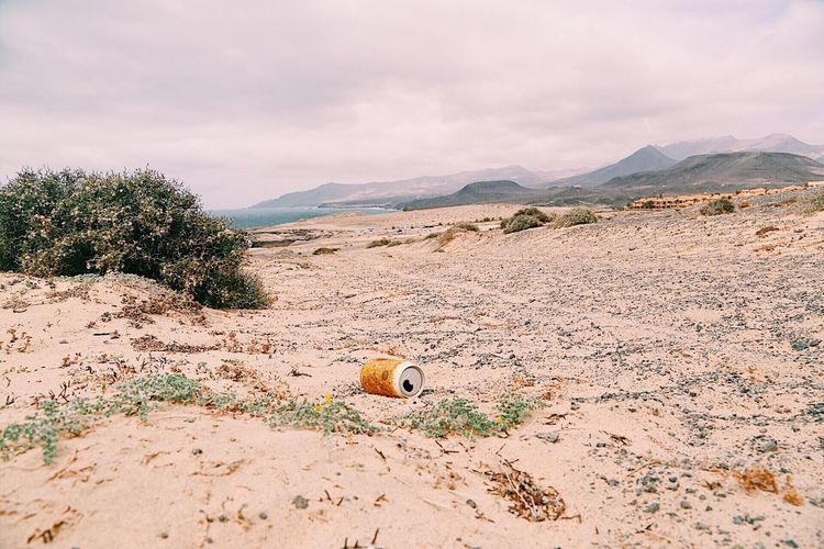 Abandoned drink can at desert