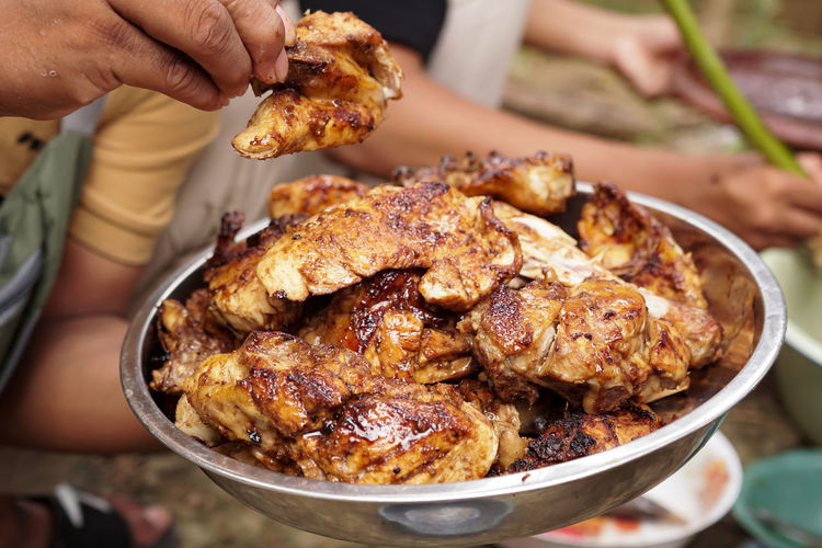High angle view of person holding meat in plate
