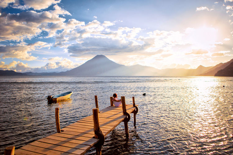 Water Sky Beauty In Nature Scenics - Nature Mountain Sunlight Cloud - Sky Nature Tranquility Lake Sunset Tranquil Scene Pier Idyllic Lifestyles Sun Outdoors Guatemala Volcano Nature Travel Destinations Travel Travel Photography Traveling Wanderlust