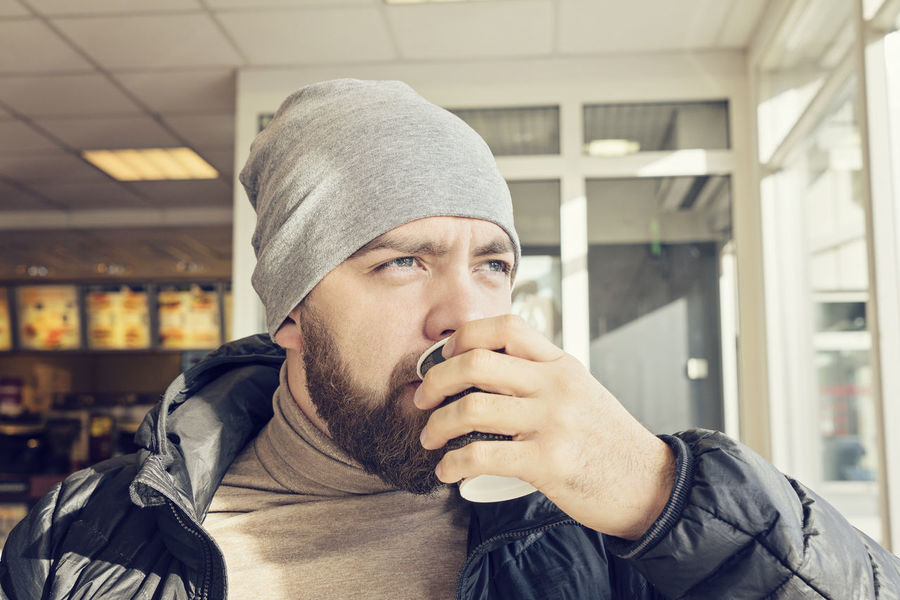 Breakfast Coffee Time Beanie Bearded Cafe Cap Close-up Cup Of Coffee Day Drink Drinking Gas Station Headshot Indoors  Lifestyles Moring One Person Portrait Real People Take Away Coffee Warm Clothing Young Adult Young Men Take A Break Away