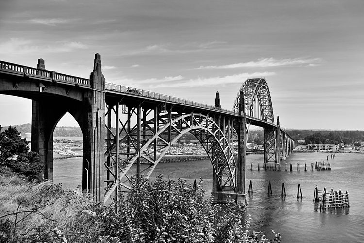 Perspective Yaquina Bay Bridge Arch Architecture Black And White Bridge - Man Made Structure Built Structure Cloud - Sky Connection Day Engineering Landscape_photography Nature No People Oregon Coast Outdoors River Shapes And Forms Sky Transportation Travel Travel Destinations Water