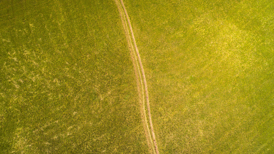 Drone  Droneshot Grass Green Color Plant Sport No People Nature Outdoors High Angle View Backgrounds Playing Field Yellow Soccer Day Beauty In Nature Competition Growth Soccer Field Full Frame Curve Field Turf Textured Effect